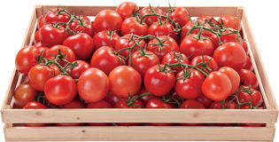 Red tomatoes in a box raw vegetables Stock Photo