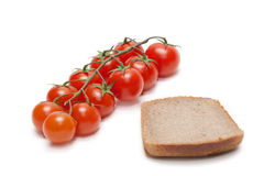 Red tomatoes cherry, pumpernickel two Royalty Free Stock Photo