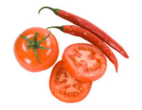Red tomatoes with chilly peppers Stock Photography