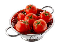 Red tomatoes in a colander Stock Image