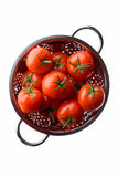 Red tomatoes in a colander Stock Photo
