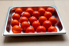 Red Tomatoes cut. Before blanch stock image