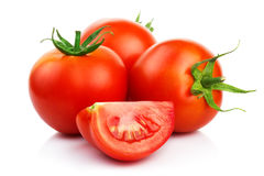 Red tomatoes with cut isolated on white Royalty Free Stock Photography