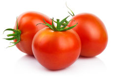 Red tomatoes with cut isolated on white Stock Images