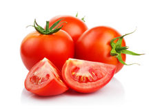 Red tomatoes with cut isolated on white Stock Image
