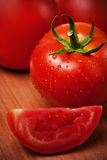 Red tomatoes on a cutting board Stock Images