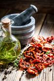 Red tomatoes dried in the sun as aromatic ingredients. On wooden table royalty free stock photography