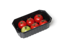 Red tomatoes in food container Royalty Free Stock Photo