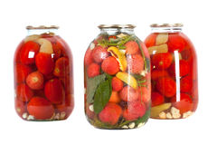 Red tomatoes in a glass jar Royalty Free Stock Photo