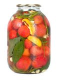 Red tomatoes in a glass jar Stock Image