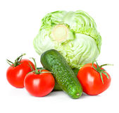 Red tomatoes, green cucumbers and cabbage Royalty Free Stock Photos