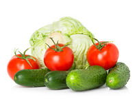 Red tomatoes, green cucumbers and cabbage Stock Photo