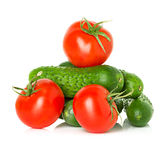 Red tomatoes and green cucumbers Stock Photos