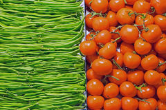 Red tomatoes and green peas Stock Photography