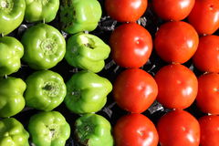 Red tomatoes and green peppers Royalty Free Stock Photo