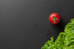 Red tomatoes with green salad Royalty Free Stock Photos
