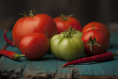 Red tomatoes and green tomatillos Royalty Free Stock Photo