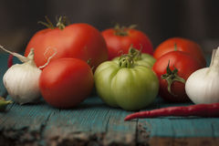 Red tomatoes and green tomatillos Stock Photo