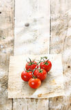 Red tomatoes in a grungy rustic kitchen Royalty Free Stock Image