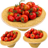 Red tomatoes in a hat. Royalty Free Stock Image