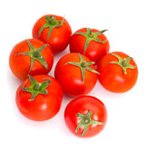 Red tomatoes isolated. On the white Royalty Free Stock Photos