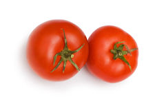 Red tomatoes isolated on the white background. Red tomatoes isolated on  the white background Stock Photography