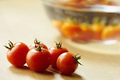 Red tomatoes on kitchen table Royalty Free Stock Image