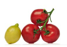 Red tomatoes and lemon. Over white background Royalty Free Stock Photos
