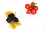 Red tomatoes, linguine and fettucini squid ink Royalty Free Stock Photography