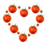 Red tomatoes love heart design. Red tomato vegetable  in love  heart shape pattern  design isolated white background Stock Photo