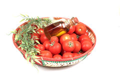 Red tomatoes and olive oil Stock Photography