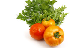 Red tomatoes with parsley leaves Royalty Free Stock Image