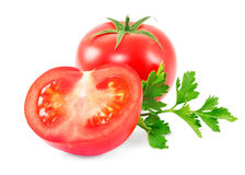 Red tomatoes with parsley leaves Stock Image