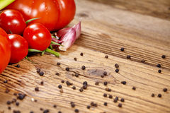 Red tomatoes with pepper Royalty Free Stock Images