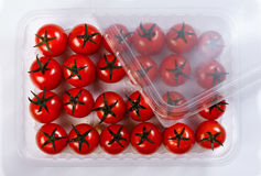 Red tomatoes in a plastic container Stock Photos