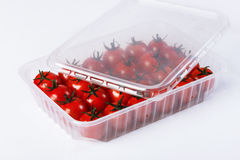 Red tomatoes in a plastic container Stock Photography