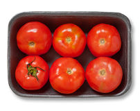 Red tomatoes in a plastick pack. Isolated. Royalty Free Stock Photography