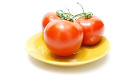 Red Tomatoes on Plate Royalty Free Stock Images