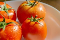 Red tomatoes with selective focus and crop fragment Stock Photo