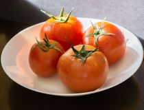 Red tomatoes with selective focus and crop fragment Stock Image