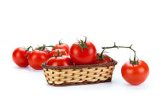 Red tomatoes in a small basket on a white background Stock Images