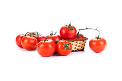 Red tomatoes in a small basket on a white background Royalty Free Stock Photography