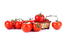 Red tomatoes in a small basket on a white background Royalty Free Stock Image