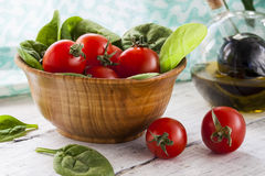 Red Tomatoes and Spinach Stock Photography