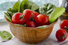 Red Tomatoes and Spinach Royalty Free Stock Photos