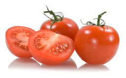 Red tomatoes with two tomato segments Royalty Free Stock Image