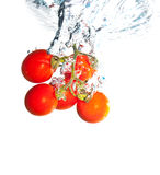 Red tomatoes under water. With a trail of transparent bubbles isolated on white Stock Photography