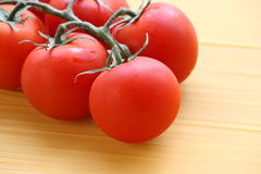 Red Tomatoes on the Vine Stock Photography