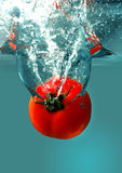 Red tomatoes in water Stock Photo