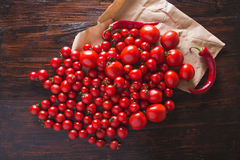 Red tomatoes with water drops. Tomatoes of different varieties. omatoes background. Fresh tomatoes Healthy food concept. Stock Images